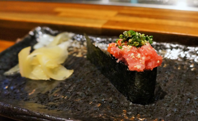Gunkan Sushi is oval in shaped with a strip of seaweed wrapping around its core