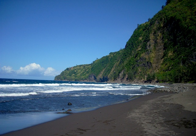 Waipi'o Black Sand Beach is surrounded by the Waipi'o Valley