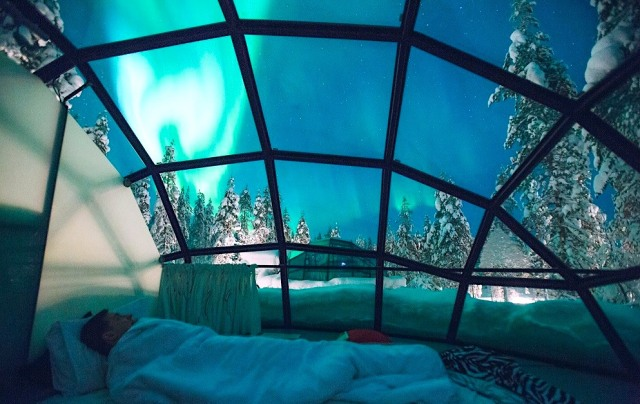 Hotel Kakslauttanen offers guests the option of comfort while admiring the Northern Lights