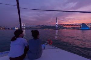 Enjoying Busan night view on a yacht